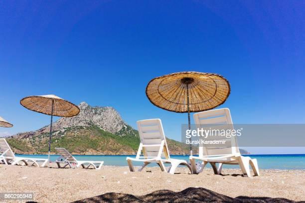 Umbrella and sunloungers in Adrasan, Turkey