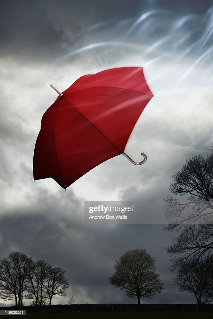 Umbrella caught up in the wind on a stormy day : Stock Photo