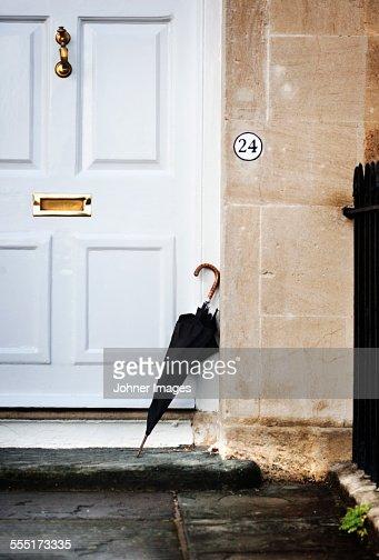 Umbrella leaning near door