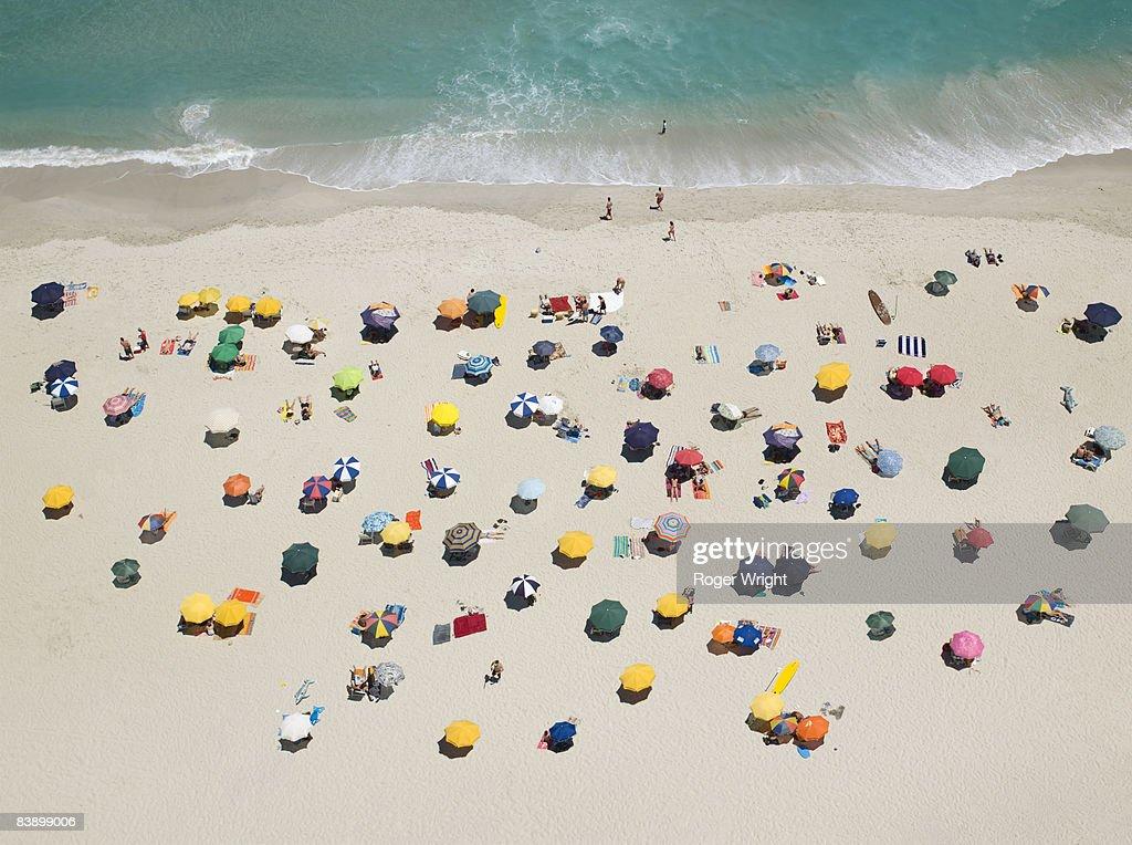 Umbrella pattern on beach : Stock Photo