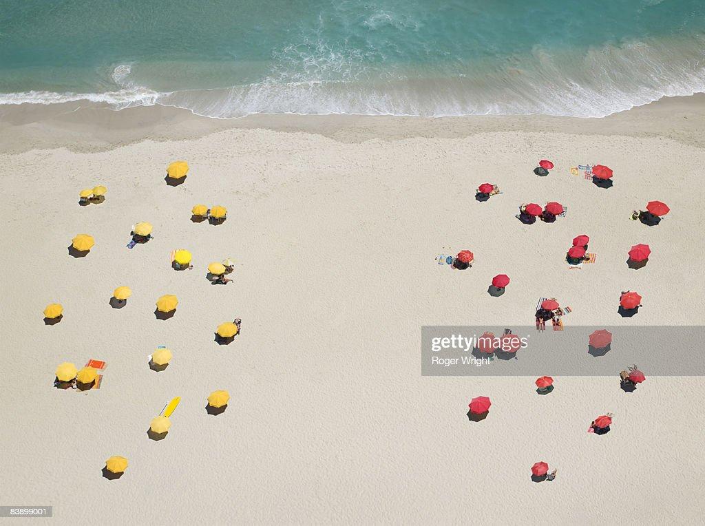 Umbrella patterns on beach : Stock Photo