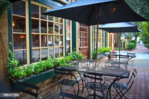 Umbrella shaded outdoor seating of cafe bistro