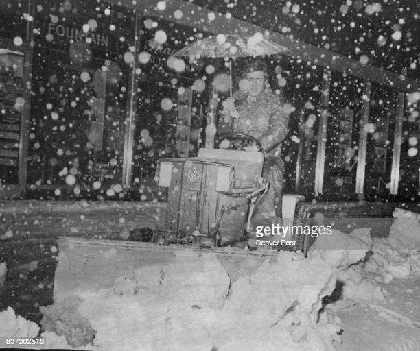 Umbrella Wasn't Made for Blizzard Brown Palace Hotel employee Ernest McCarther protected by umbrella blasts through the snow piled on a downtown...