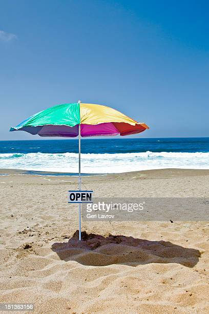 Umbrella with open sign at the beach