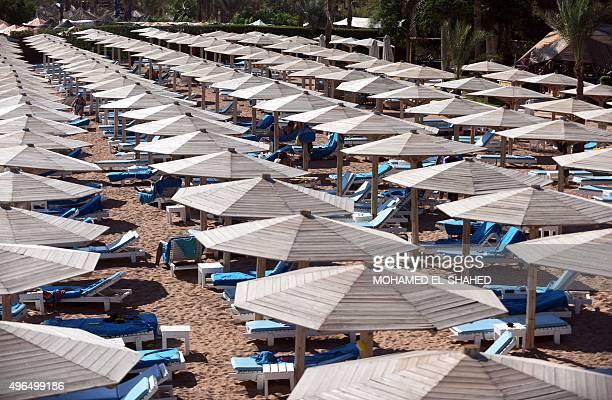Umbrellas and sunbeds are seen on a beach in Egypt's Red Sea resort of Sharm ElSheikh on November 10 2015 As visitors stranded after the crash of a...