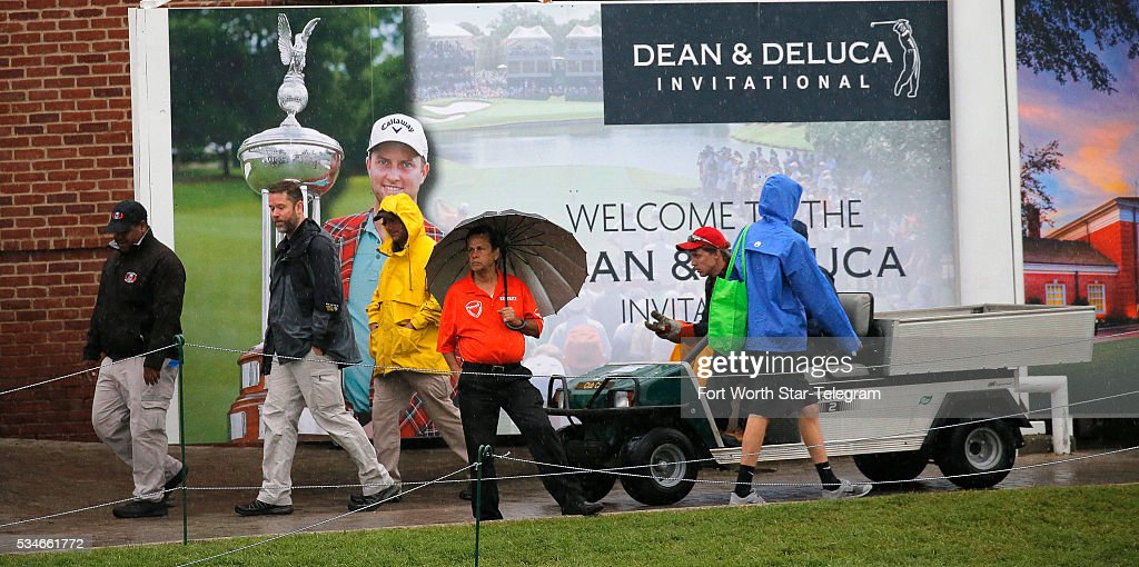 Umbrellas are needed as weather delays the start of play during the second day of the Dean & DeLuca Invitational Golf Tournament at the Colonial Country Club, Friday, May 27, 2016 in Fort Worth, Texas.