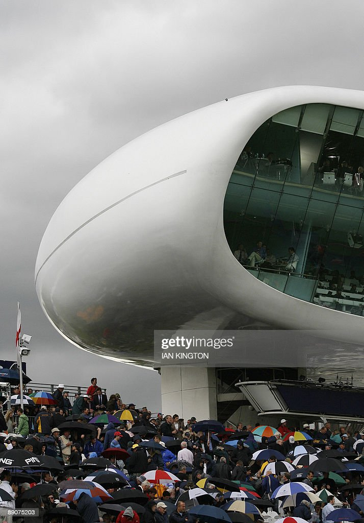 Umbrellas are put up by spectators under the Media Centre after rain stops play in the game between England and Australia during the second day of...