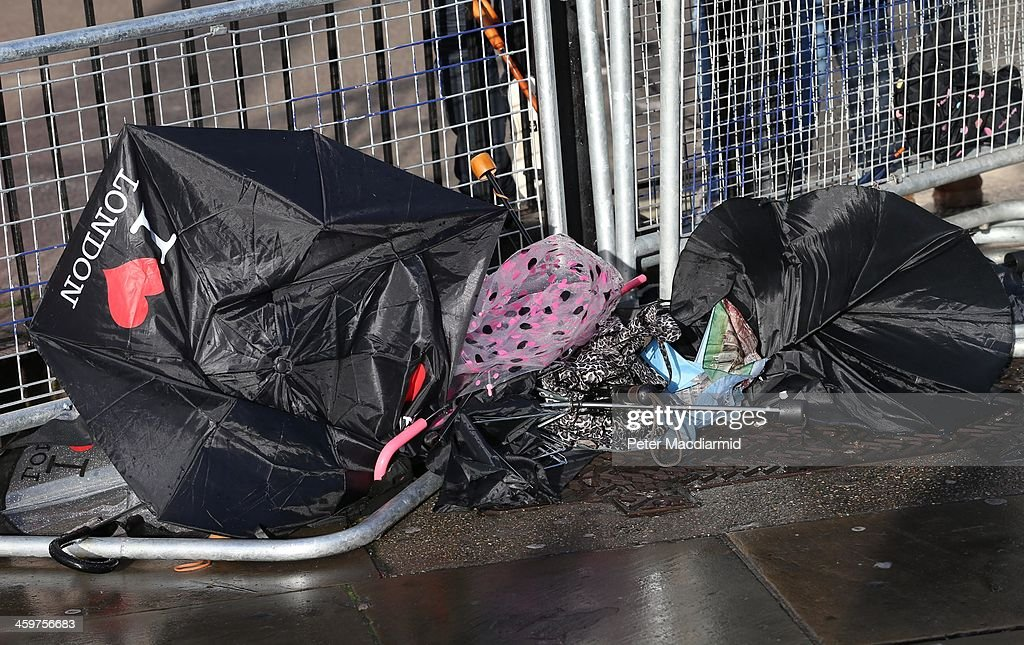 Umbrellas lie abandoned in wet and windy conditions on December 30, 2013 in London, England. Parts of the United Kingdom are experiencing wintry conditions.