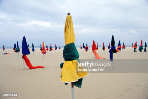 Umbrellas on empty beach : Stock Photo