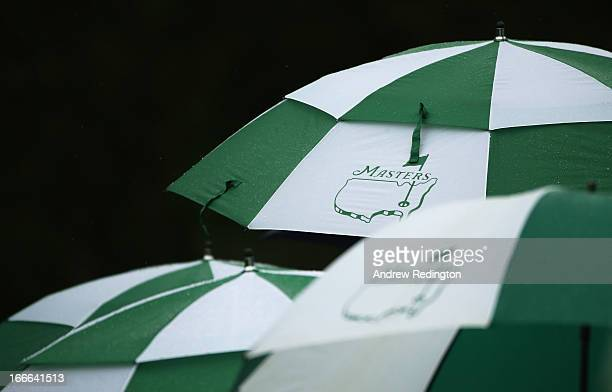 Umbrellas with the Master's logo is seen during the final round of the 2013 Masters Tournament at Augusta National Golf Club on April 14 2013 in...