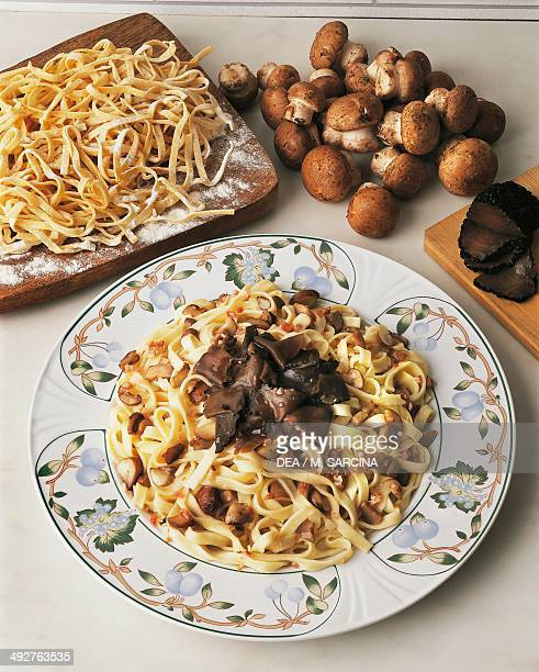 Umbrianstyle homemade tagliatelle with mushrooms and black truffle