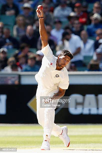 Umesh Yadav of India bowls during day one of the Third Test match between Australia and India at Melbourne Cricket Ground on December 26 2014 in...