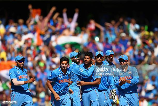 Umesh Yadav of India celebrates after taking the wicket of David Warner of Australia during the 2015 Cricket World Cup Semi Final match between...