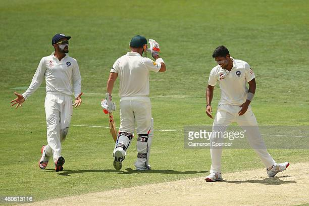 Umesh Yadav of India celebrates dismissing David Warner of Australia during day two of the 2nd Test match between Australia and India at The Gabba on...