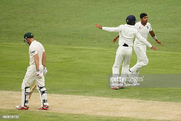 Umesh Yadav of India celebrates dismissing Shaun Marsh of Australia during day two of the 2nd Test match between Australia and India at The Gabba on...