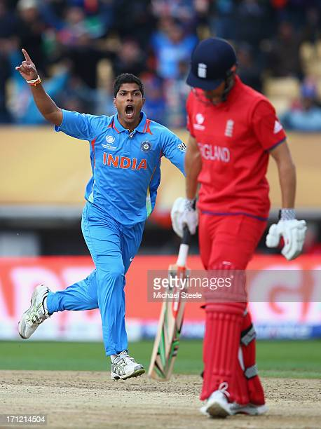 Umesh Yadav of India celebrates taking the wicket of Alastair Cook of England during the ICC Champions Trophy Final match between England and India...