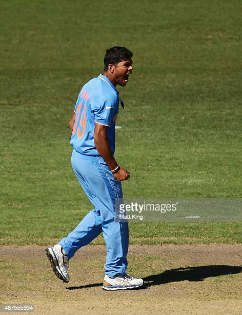 Umesh Yadav of India celebrates taking the wicket of David Warner of Australia during the 2015 Cricket World Cup Semi Final match between Australia...
