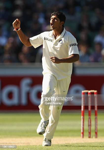 Umesh Yadav of India celebrates the wicket of Peter Siddle of Australia during day three of the First Test match between Australia and India at the...