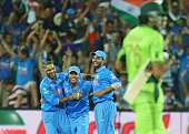 Umesh Yadav of India celebrates with Shikhar Dhawan and Ajinkya Rahane after taking a catch to dismiss Sohail Khan of Pakistan and win the match...