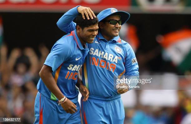 Umesh Yadav of India celebrates with team mate Virender Sehwag after taking the wicket of Kumar Sangakkara of Sri Lanka during game eight of the One...