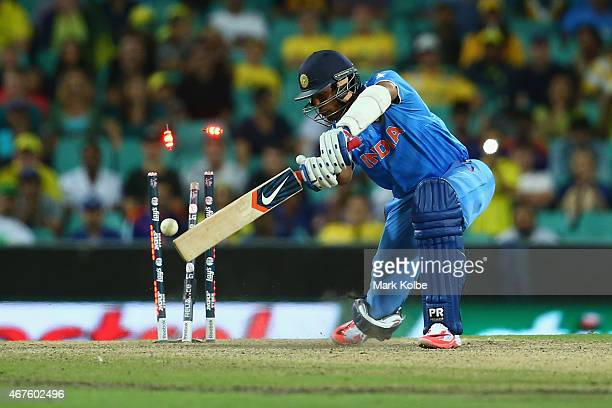Umesh Yadav of India is bolwed by Mitchell Starc of Australia during the 2015 Cricket World Cup Semi Final match between Australia and India at...