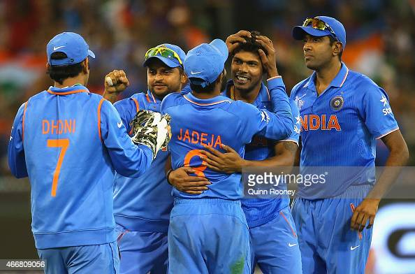 Umesh Yadav of India is congratulated by team mates after getting the wicket of Mushfiqur Rahim of Bangladesh during the 2015 ICC Cricket World Cup...