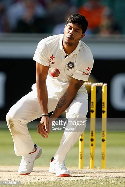 Umesh Yadav of India stops a ball during day four of the Third Test match between Australia and India at Melbourne Cricket Ground on December 29 2014...