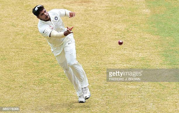 Umesh Yadav of India throws to the wicket keeper after fielding a shot by Darren Bravo of the West Indies off a delivery from bowler Mohammed Shami...