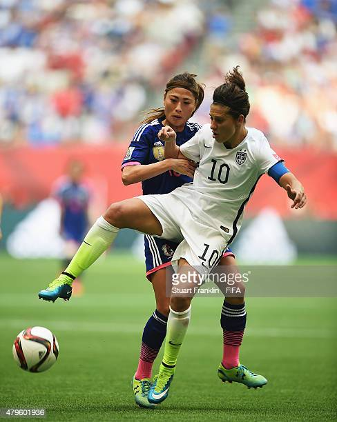 umi Utsugi of Japan challenges Carli Lloyd of USA during the FIFA Women's World Cup Final between USA and Japan at BC Place Stadium on July 5 2015 in...