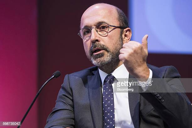 Umit Leblebici chief executive officer of Turk Ekonomi Bankasi AS gestures as he speaks on a panel during the BloombergHT investor conference in...