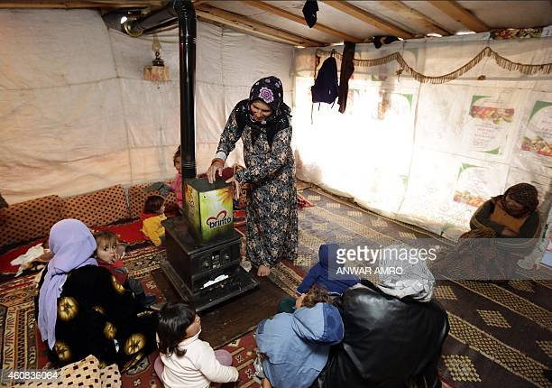 ASSIR Umm Ali the mother of eleven children and who is currently sixmonths pregnant puts fuel into the 'sobia' a traditional Middle Eastern diesel or...