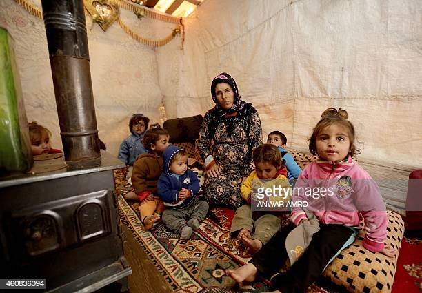 ASSIR Umm Ali the mother of eleven children and who is currently sixmonths pregnant sits by the 'sobia' a traditional Middle Eastern diesel or...