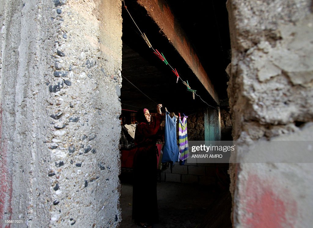 Umm Deeb, a 25-year-old Syrian refugee, hangs the laundry to dry at her house in the northern Lebanese town of Halba on November 20, 2012. Syrian refugees in Lebanon are demanding the creation of a camp like in Turkey and Jordan, but the Lebanese government and the United Nations reject the idea.