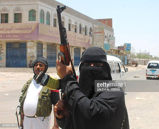 Umm Raed a female fighter with Yemens separatist Southern Movement who says she is eight months pregnant holds an automatic rifle while manning a...