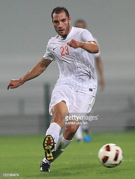 Umm Salal's Algerian midfielder Mourad Meghni controls the ball during their Sheikh Jassem Cup football match against AlArabi in the Qatari capital...