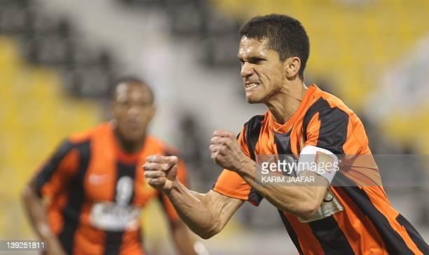 Umm Salal's Brazilian striker Magno Alves celebrates after scoring a goal against AlAhli during their Qatar Stars League football match in Doha on...