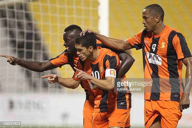 Umm Salal's Brazilian striker Magno Alves celebrates after scoring a goal against AlAhli during their Qatar Stars League football match in Doha on...