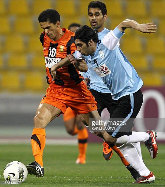 Umm Salal's Brazilian striker Magno Alves challenges AlWakra's Yussef Muftah during their Qatar Stars League football match in Doha on January 28...