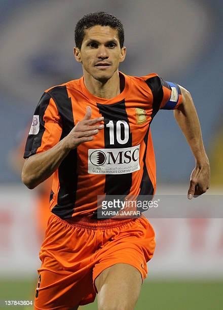 Umm Salal's Brazilian striker Magno Alves runs during their Qatar Stars League football match against AlWakra in Doha on January 28 2012 AFP...