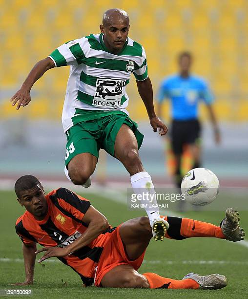 Umm Salal's Mohammed Hussain of Bahrain challenges AlAhli's Ewerthon during their Qatar Stars League football match in Doha on February 18 2012 AFP...