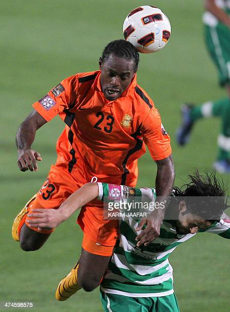Umm Salal's Nigerian forward Tchuka Derik challenges AlAhli's Imad Nasser during their Qatar Stars League football match in Doha on April 15 2011...