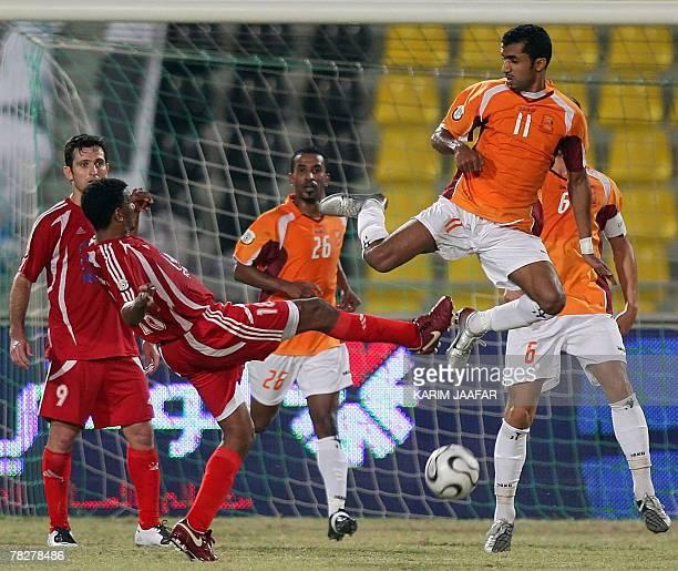 Umm Salal's Omani player Ismael alAjmi vies with AlShamal's Ihab Ser alKhatim during their Qatari championship football match in Doha 05 December...