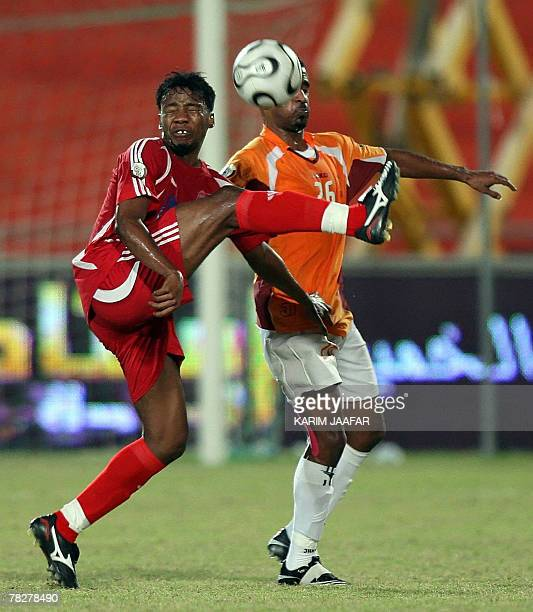 Umm Salal's player Dahi alNubi vies with AlShamal's Ahmed Hadid during their Qatari championship football match in Doha 05 December 2007 AFP...