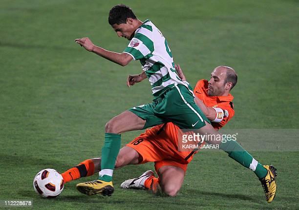 Umm Salal's Spanish midfielder Gabri Garcia challenges AlAhli's Ali Khamis during their Qatar Stars League football match in Doha on April 15 2011...