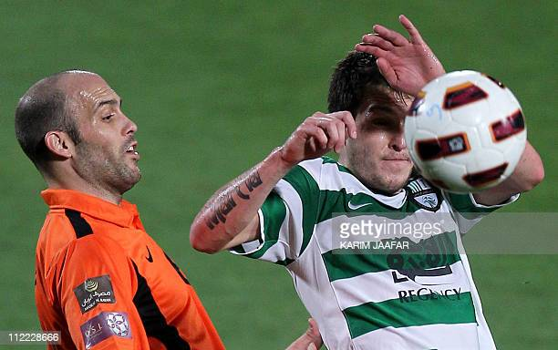 Umm Salal's Spanish midfielder Gabri Garcia challenges AlAhli's Brazilian midfielder Wagner Ribeiro during their Qatar Stars League football match in...