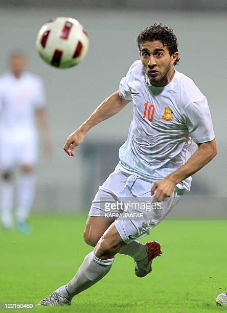 Umm Salal's Syrian forward Firas alKhatib eyes the ball during their Sheikh Jassem Cup football match against AlArabi in the Qatari capital Doha late...