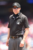 Umpire Adam Hamari looks on during a baseball game between the Washington Nationals and the San Diego Padres at Nationals Park on July 24 2016 in...