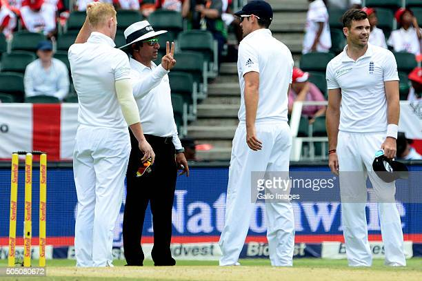 Umpire Aleem Dar gives James Taylor of England his second warning for running on the danger area of the wicket during day 2 of the 3rd Test match...