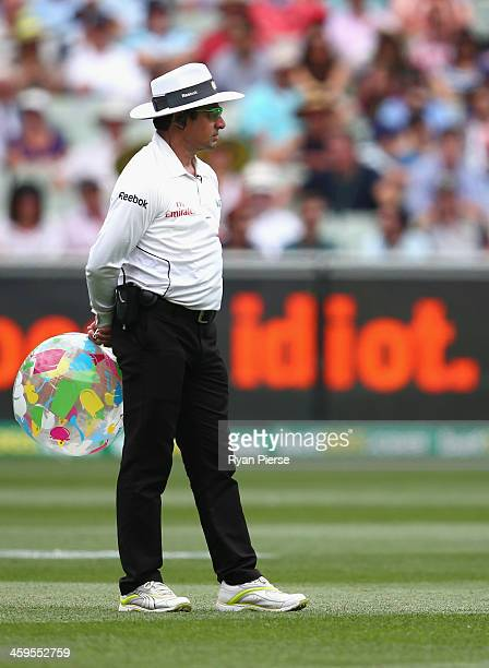 Umpire Aleem Dar holds a beach ball during day three of the Fourth Ashes Test Match between Australia and England at Melbourne Cricket Ground on...