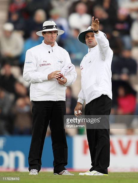 Umpire Aleem Dar points to a dark cloud over the ground with Rod Tucker during day four of the 3rd npower Test Match between England and Sri Lanka at...